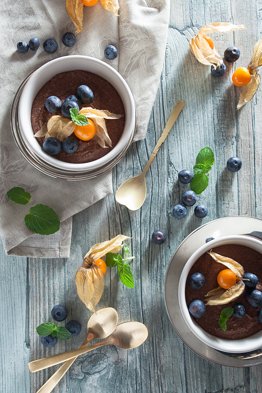 Recipe for vegan chocolate mousse made of silken tofu with peanut butter, blueberries and physalis.