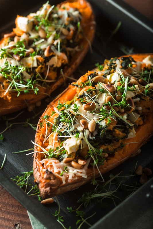 Recipe for stuffed sweet potato with spinach, feta cheese, parmesan and pine seeds. Comforting, simple and delicious! Recipe and Food Photography from Purple Avocado / Sabrina Dietz