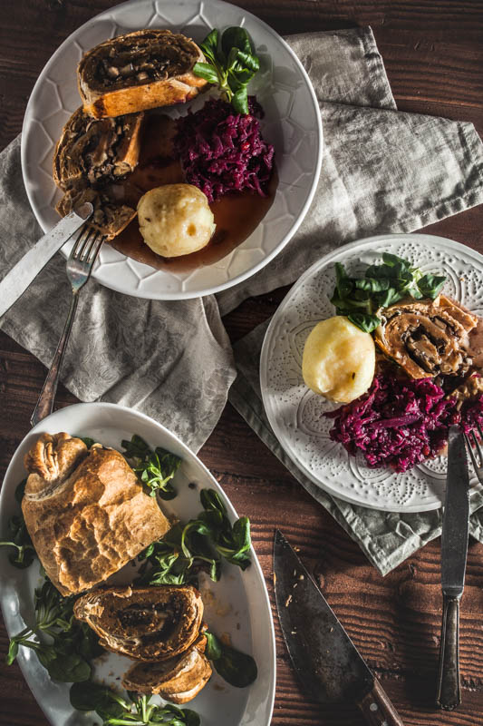 Vegan Seitan recipe - Roast from above, served on two different plates with red cabbage and potato dumplings