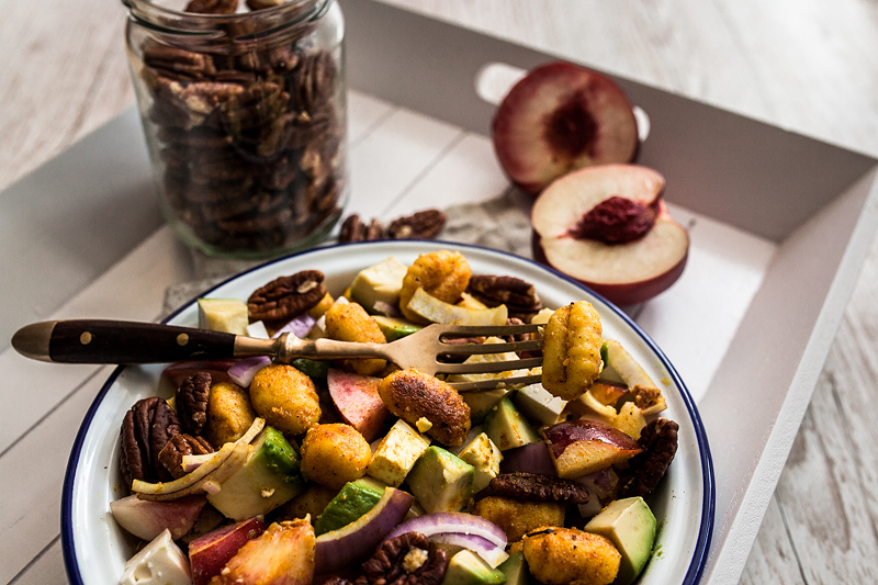 Quick and satisfying Curry Gnocchi Salad with nectarines, feta cheese, roasted pecan nuts and creamy avocado. The perfect summer salad that can be savoured warm and cold and is perfectly suited to be taken out for picnics or barbecue with friends. Recipe and food styling from Purple Avocado / Sabrina Dietz