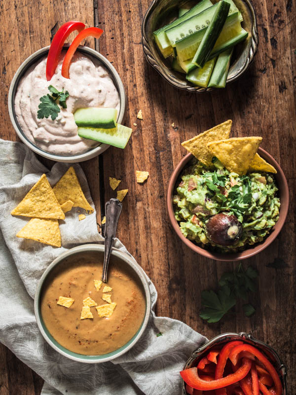 Mexican party food: 3 vegan dips for tacos, tortillas and nachos. Guacamole, Sour cream and cheesy queso dip with egg plant
