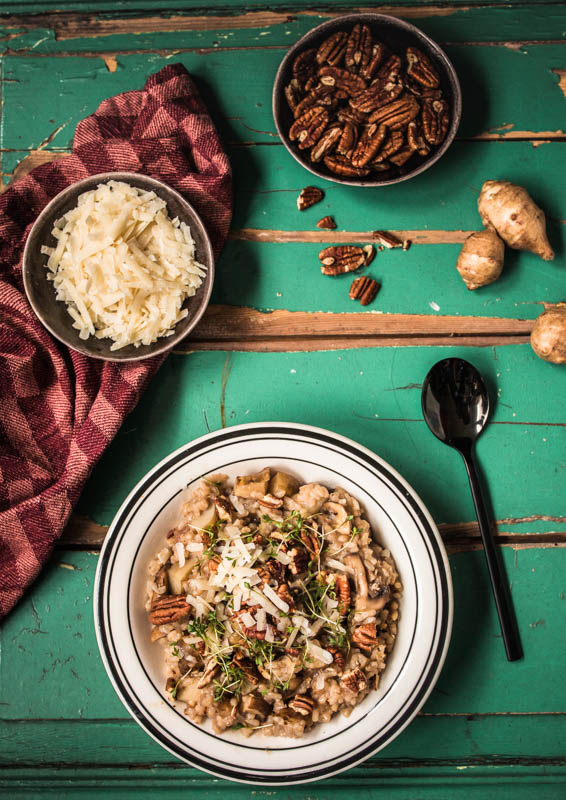 Recipe for a creamy risotto with mushrooms, sunchoke (topinambour) and chopped pecan nuts. Cozy, comforting winter food. #foodstyling #foodphotographer #recipes