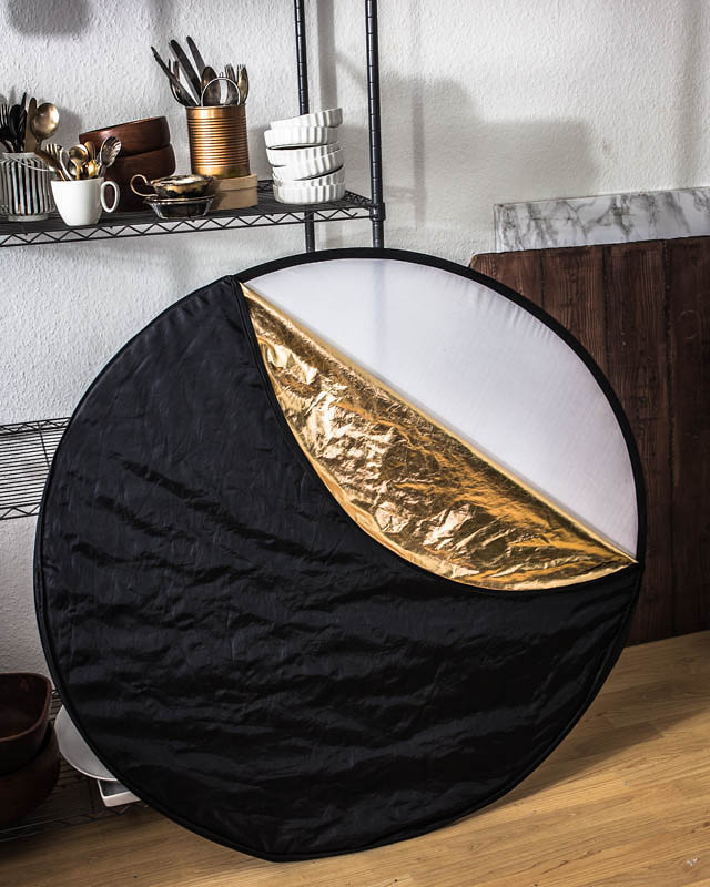 Collapsible reflector with golden, silver, black and white surface