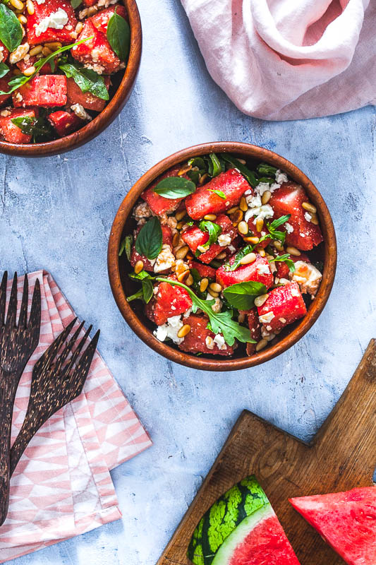 Two bowls of a summer watermelon basil feta salad