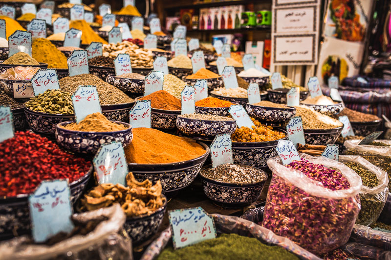 Spice mixtures in big bowls and bags at Vakil Bazar