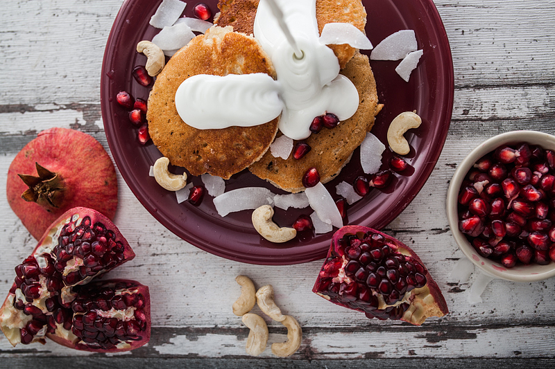 Recipe for Cashew Butter Coconut Milk Pancakes with a Curd Coconut Topping garnished with Cashew Seeds and Pomegranate. Foodstyling and Recipe from Purple Avocado / Sabrina Dietz