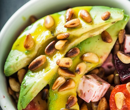 Recipe for a creamy avocado salad with roasted Pine Seeds, Beetroot, Tomato, Feta Cheese and a rich and hearty tahini dressing. Recipe and Foodstyling from Purple Avocado