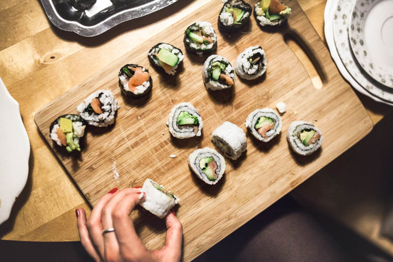 Sushi filling ideas - Different pieces of sushi on a wooden cutting board
