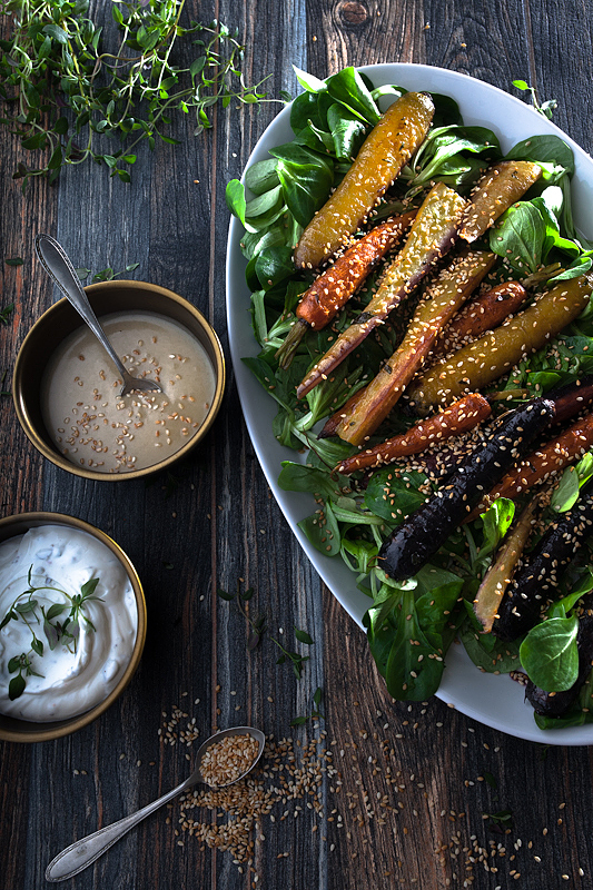 Colorful carrots from the oven and mache with a sesame dressing