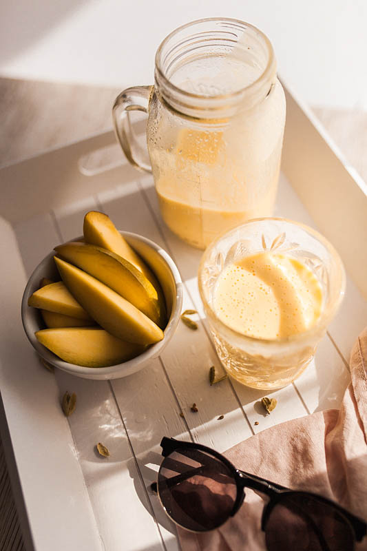 The Mango Lassi - a refreshing yoghurt drink from india - is the perfect summer recipe or side to your hot and spicy food. Even the vegan Mango Lassi is easily made. Foodstyling and Food Photography from Purple Avocado / Sabrina Dietz