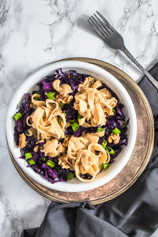 Creamy hummus sauce pasta with crisp red cabbage & roasted walnuts