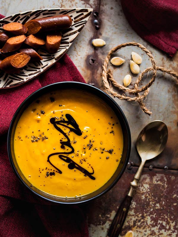 Vegan coconut pumpkin soup with maple syrup and curry. We're adding vegan merguez by Wheaty for the salty touch and bite. #recipe #foodstyling #fall #autumn #recipes #pumpkin #hokkaido