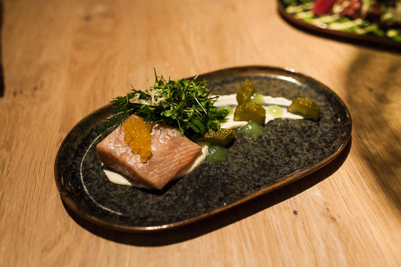 Homemade smoked salmon with pumpkin seed crème fraîche. Restaurant Guide Hamburg, Hygge