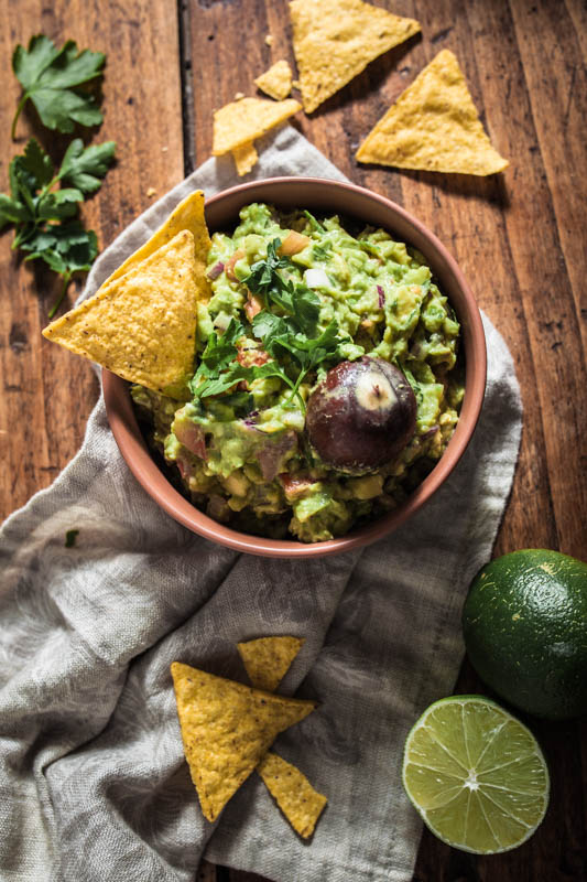 Homemade guacamole with nachos for a Mexican food party