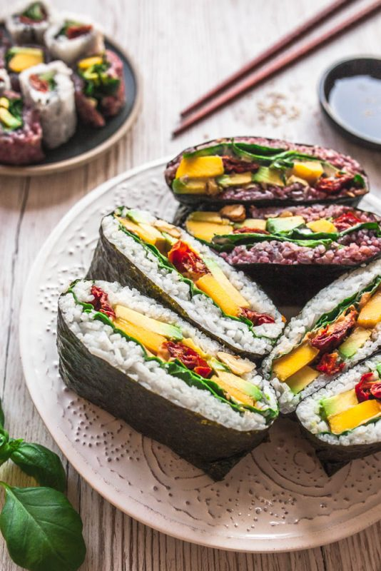 Onigirazu or Sushi Sandwiches are an easy & versatile alternative to your ordinary lunch and SO delicious! I've got you covered with delicious onigirazu filling ideas as well as a video tutorial. #vegan #vegetarian #sushi #sandwiches #onigiri