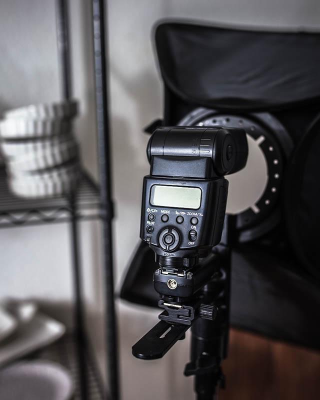 A photo flash mounted onto a square softbox