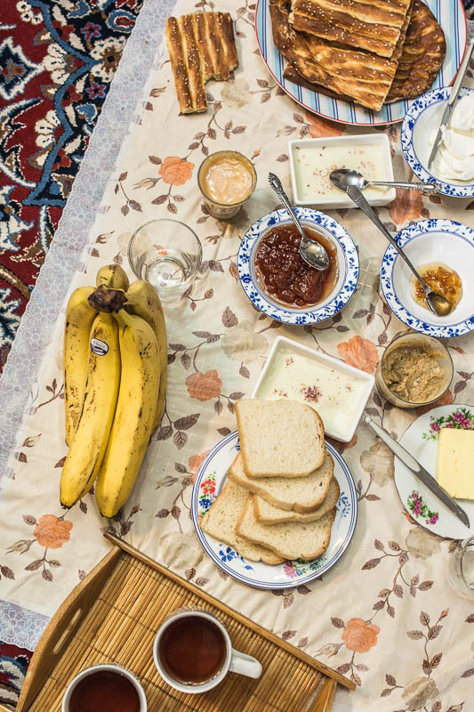 Traditional Iranian breakfast with bread, fruit, jam and - of course - tea