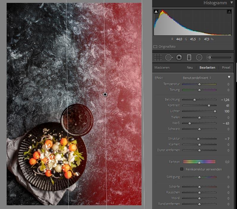 Screenshot von Lightroom Oberfläche. Ein linearer Verlaufsfilter wird über ein Foodfoto mit dunklem Untergrund gelegt um hellere Bereiche zu korrigieren